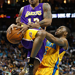 February 5, 2011; New Orleans, LA, USA; Los Angeles Lakers point guard Shannon Brown (12) is fouled by New Orleans Hornets guard Marcus Thornton (5) during the fourth quarter at the New Orleans Arena. The Lakers defeated the Hornets 101-95.  Mandatory Credit: Derick E. Hingle