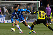 Gillingham forward Dominic Samuel skips the ball past Burton Albion midfielder Hamza Choudhury during the Sky Bet League 1 match between Burton Albion and Gillingham at the Pirelli Stadium, Burton upon Trent, England on 30 April 2016. Photo by Aaron  Lupton.