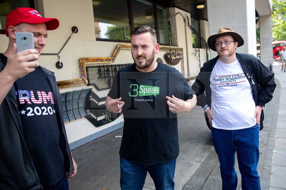 © Licensed to London News Pictures. 22/07/2019. London, UK. Pro-Brexit activist and yellow vest demonstrator James Goddard (centre) arrives at Westminster Magistrates' Court where he will be sentenced, after admitting to harassing pro-remain MP Anna Soubry by calling her a 'Nazi'. Photo credit : Tom Nicholson/LNP