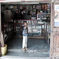 A young boy looks out of a shop in Stonetown, Zanzibar