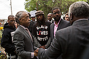 Rev. Al Sharpton speaks with local activist Muhiydin Moye D'Baha of the Black Lives Matter following a peace vigil at the spot where unarmed motorist Walter Scott was gunned down by police April 12, 2015 in North Charleston, South Carolina. About 100 people showed up for the brief vigil following a healing service at Charity Mission Baptist Church.