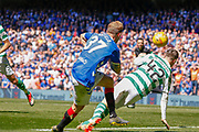 Scott Arfield of Rangers FC gets another chance only to be blocked by Callum McGregor of Celtic FC during the Ladbrokes Scottish Premiership match between Rangers and Celtic at Ibrox, Glasgow, Scotland on 12 May 2019.