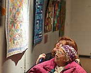 Candie Edmonds (top) and her grandmother, Evelyn Snethen, both of Cedar Rapids, look at various quilts on display during a reception for the Art Quilt Exhibit at The Carl & Mary Koehler History Center, 615 1st Ave SE in Cedar Rapids on Saturday morning, March 3, 2012. (Stephen Mally/Freelance)