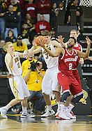 December 31 2012: Iowa Hawkeyes guard Mike Gesell (10), Iowa Hawkeyes center Adam Woodbury (34), and Indiana Hoosiers forward Christian Watford (2) battle for a rebound during the first half of the NCAA basketball game between the Indiana Hoosiers and the Iowa Hawkeyes at Carver-Hawkeye Arena in Iowa City, Iowa on Monday December 31, 2012. Indiana defeated Iowa 69-65.