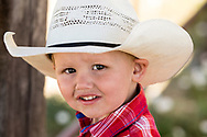 Young cowboy, Ingomar, Montana, during annual rodeo