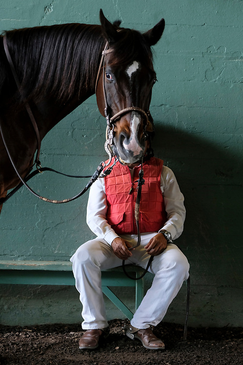 Outrider Francisco Cardenas sits with horse Trophy while waiting to escort the race horses to the track at Santa Anita Park, May 5 in Arcadia, CA. <br /> Photo by Philip B. Poston/Sports Shooter Academy