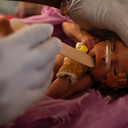 A baby, estimated to be two months premature, being examined by a doctor at the Médecins Sans Frontières (MSF) health centre at the Mbera camp for Malian refugees in Mauritania on 3 March 2013.