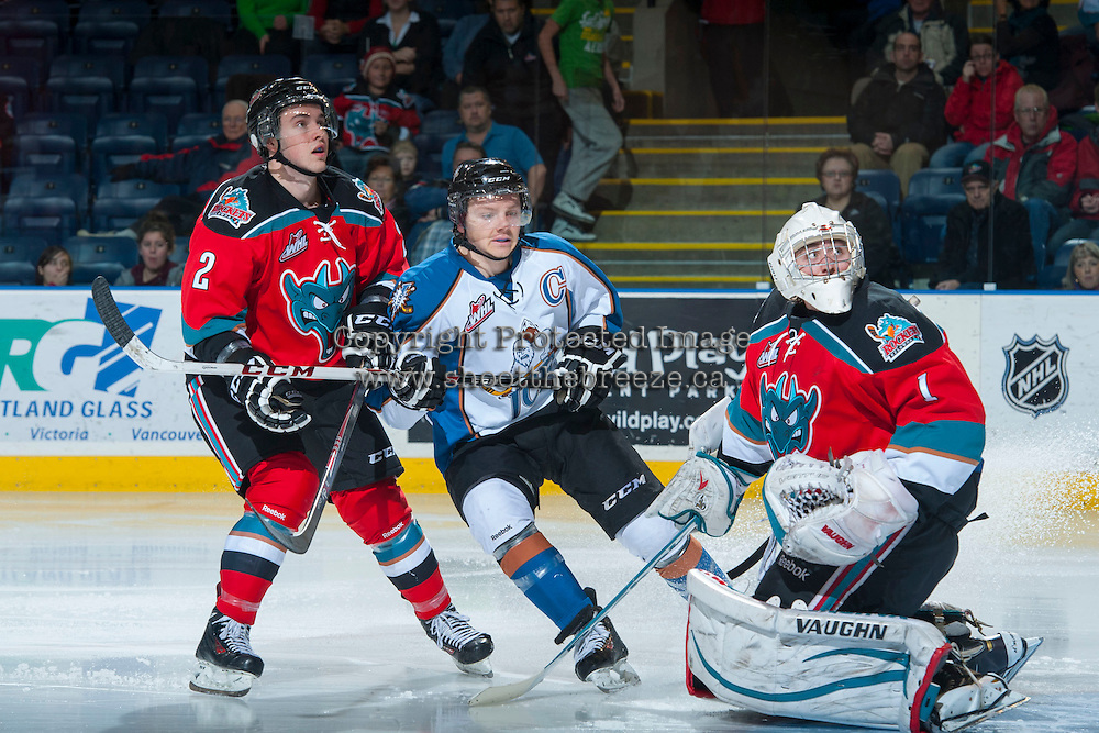 KELOWNA, CANADA - DECEMBER 7: Jesse Lees #2 and Jackson Whistle #1 of the Kelowna Rockets watch the rebound from a shot from Sam Reinhart #23 of the Kootenay Ice on December 7, 2013 at Prospera Place in Kelowna, British Columbia, Canada.   (Photo by Marissa Baecker/Shoot the Breeze)  ***  Local Caption  ***
