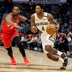 Oct 11, 2018; New Orleans, LA, USA; New Orleans Pelicans guard Elfrid Payton (4) drives past Toronto Raptors guard Jordan Loyd (8) during the first half at the Smoothie King Center. Mandatory Credit: Derick E. Hingle-USA TODAY Sports