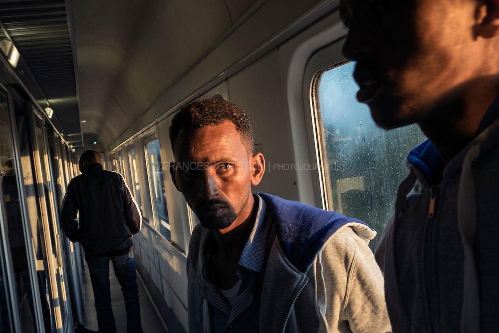 In this pictures: Early morning. Train from Rome to Brennero (northern Italy). After a 12h travel, the next station will be Brennero (Italian-Austrian border), their last Italian stop. About 70 to 100 African migrants and asylum seekers try to reach the Italian border with Austria everyday.<br />
