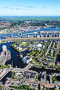 Nederland, Noord-Holland, Amsterdam, 27-09-2015; Overzicht Marineterrein en omgeving, inclusief Scheepvaartmuseum. Kattenburg en Oosterdok met de IJtunnel en museum Nemo. Oosterdokseiland (ODE), Centraal Station, water van het IJ. Amsterdam-West en Amsterdam-Noord int 't verschiet.<br /> View on Navy area (center) and the National Maritime Museum (left, white building). Museum Nemo (copper green), central station, newly constructed buildings. <br /> <br /> luchtfoto (toeslag op standard tarieven);<br /> aerial photo (additional fee required);<br /> copyright foto/photo Siebe Swart