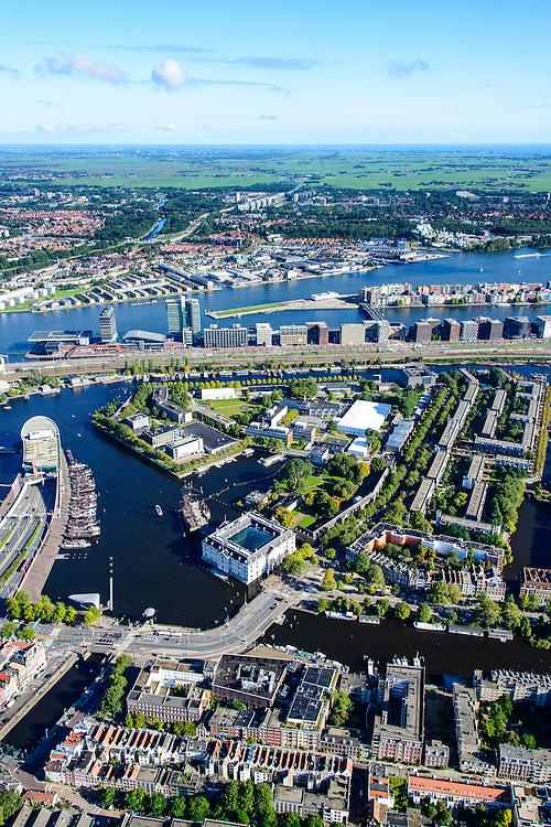 Nederland, Noord-Holland, Amsterdam, 27-09-2015; Overzicht Marineterrein en omgeving, inclusief Scheepvaartmuseum. Kattenburg en Oosterdok met de IJtunnel en museum Nemo. Oosterdokseiland (ODE), Centraal Station, water van het IJ. Amsterdam-West en Amsterdam-Noord int 't verschiet.<br /> View on Navy area (center) and the National Maritime Museum (left, white building). Museum Nemo (copper green), central station, newly constructed buildings. <br /> <br /> luchtfoto (toeslag op standard tarieven);<br /> aerial photo (additional fee required);<br /> copyright foto/photo Siebe Swart