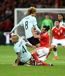Marouane Fellaini of Belgium clatters Gareth Bale of Wales  - Mandatory by-line: Joe Meredith/JMP - 01/07/2016 - FOOTBALL - Stade Pierre Mauroy - Lille, France - Wales v Belgium - UEFA European Championship quarter final