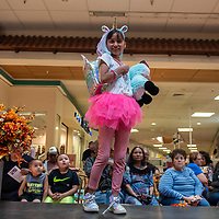 Kyra Plummer, 10, shows off Claire's fall must haves during the 5th Annual Fall Fashion Show at the Rio West Mall in Gallup.