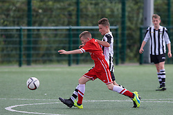 NEWPORT, WALES - Thursday, August 4, 2016: North Wales Academy Boys' Thomas Kelly [L] and South Wales Academy Boys' Scott Lewis [R] during the Welsh Football Trust Cymru Cup 2016 at Newport Stadium. (Pic by Paul Greenwood/Propaganda)