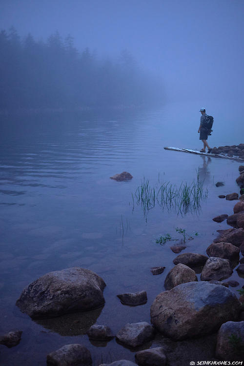 A photographer explores a foggy Jordan Pond at dusk in Acadia National Park, ME.