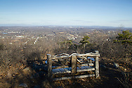 Cornwall, New York - This bench on Schunnemunk Mountain offers a view to the west and northwest. The Moodna Viaduct railroad trestle is visible above the middle of the bench. The Shawangunk Ridge is in the background at left.