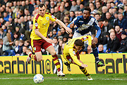 Birmingham City midfielder Jacques Maghoma attempts to take on Burnley midfielder Dean Marney and Burnley defender Matthew Lowton during the Sky Bet Championship match between Birmingham City and Burnley at St Andrews, Birmingham, England on 16 April 2016. Photo by Alan Franklin.