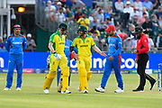 Steve Smith of Australia walks out to bat and is met by David Warner of Australia during the ICC Cricket World Cup 2019 match between Afghanistan and Australia at the Bristol County Ground, Bristol, United Kingdom on 1 June 2019.