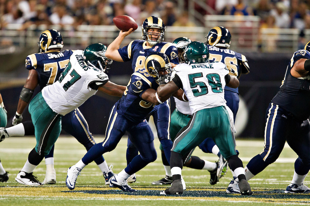 ST. LOUIS, MO - SEPTEMBER 11:   Sam Bradford #8 of the St. Louis Rams throws a pass under pressure against the Philadelphia Eagles at the Edward Jones Dome on September 11, 2011 in St. Louis, Missouri.  The Eagles defeated the Rams 31 to 13.  (Photo by Wesley Hitt/Getty Images) *** Local Caption *** Sam Bradford