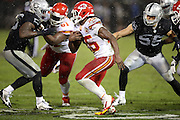 Kansas City Chiefs running back Jamaal Charles (25) looks for a hole in the defensive front as he runs for a second quarter gain of 9 yards during the NFL week 12 regular season football game against the Oakland Raiders on Thursday, Nov. 20, 2014 in Oakland, Calif. The Raiders won their first game of the season 24-20. ©Paul Anthony Spinelli