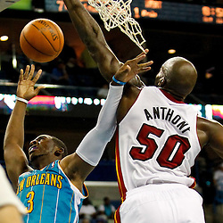 October 13, 2010; New Orleans, LA, USA; Miami Heat center Joel Anthony (50) fouls New Orleans Hornets point guard Chris Paul (3) as he shoots during the second half of a preseason game at the New Orleans Arena. The Hornets defeated the Heat 90-76. Mandatory Credit: Derick E. Hingle