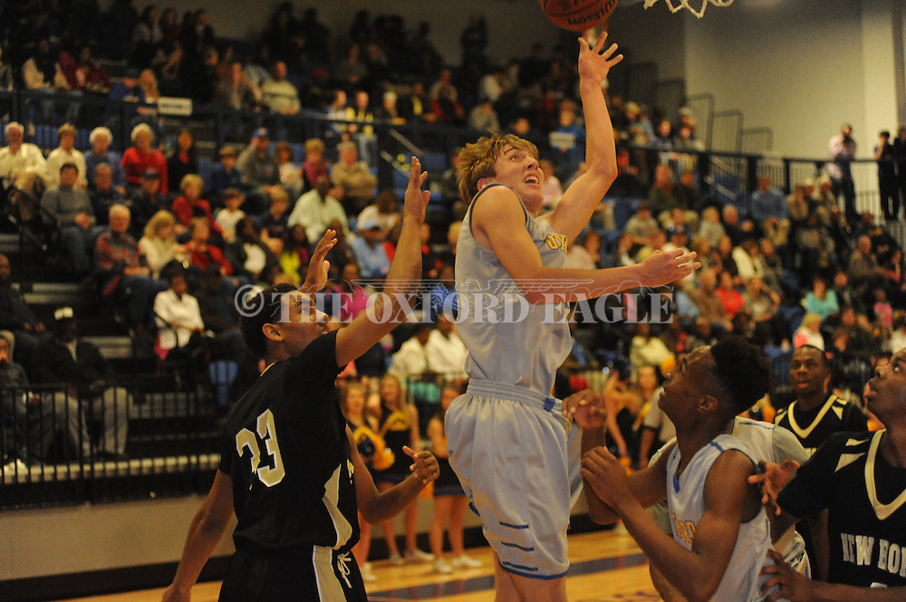Oxford High's David Dennis (20) scores against New Hope in Oxford, Miss. on Friday, February 6, 2015.