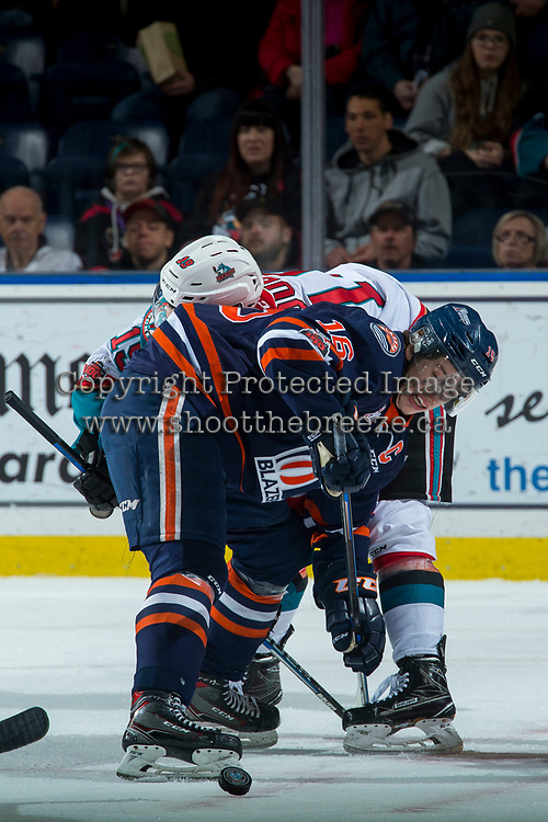 KELOWNA, CANADA - FEBRUARY 24: Nick Chyzowski #16 of the Kamloops Blazers wins the face off against Dillon Dube #19 of the Kelowna Rockets during first period  on February 24, 2018 at Prospera Place in Kelowna, British Columbia, Canada.  (Photo by Marissa Baecker/Shoot the Breeze)  *** Local Caption ***