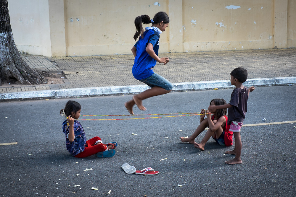 Children playing in a street of Phnom Penh, Cambodia. Photo by Lorenz Berna