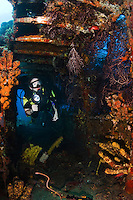 Diver inside the wreck of the Lesleen M freighter, sunk as an artificial reef in 1985 in Anse Cochon Bay, St. Lucia.