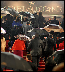 Festival staff brush water off the Red Carpet after heavy rain during the 65th Annual Cannes Film Festival at Palais des Festivals, Cannes, France, Sunday May 20, 2012. Photo by Andrew Parsons/i-Images.Guest arrive on the Red Carpet in heavy rain during the 65th Annual Cannes Film Festival at Palais des Festivals, Cannes, France, Sunday May 20, 2012. Photo by Andrew Parsons/i-Images.