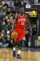 March 18, 2011; Sacramento, CA, USA;  Philadelphia 76ers point guard Jrue Holiday (11) dribbles the ball against the Sacramento Kings during the first quarter at the Power Balance Pavilion. Philadelphia defeated Sacramento 102-80.