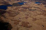 Nederland, Noord-Brabant, Limburg, 07-03-2010; Zuidelijk deel van Nationaal Park Groote Peel, op de grens van Noord-Brabant en Limburg. Aangesloten restanten hoogveen .Het huidige natuurgebied, oorspronkelijk hoogveenmoeras, bestaat naast restanten hoogveen, uit plassen en kale vlakten (met pijpenstrootje en hei) zoals overbleven zijn na het afgraven van de turf. Het huidige beschermde natuurgebied is een internationaal erkend wetland..National Park Groote Peel, southern part, remainder of the original peat bog..The present nature, original moor, exists alongside lakes and barren plains (with heather and purple moor) as remained after the excavation of peat. The current protected nature reserve is an internationally recognized wetland.luchtfoto (toeslag), aerial photo (additional fee required);.foto/photo Siebe Swart