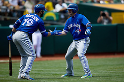 OAKLAND, CA - JULY 23:  Josh Donaldson #20 of the Toronto Blue Jays celebrates with Jose Bautista #19 after hitting a home run against the Oakland Athletics during the fifth inning at O.co Coliseum on July 23, 2015 in Oakland, California. The Toronto Blue Jays defeated the Oakland Athletics 5-2. (Photo by Jason O. Watson/Getty Images) *** Local Caption *** Josh Donaldson; Jose Bautista