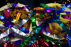 Left over plates of chicken wings are covered in confetti after competitive eaters consumed large amounts of wings during Wing Bowl 26, at the Wells Fargo Center in Philadelphia, PA, on February 2, 2018. The annual chicken wing eating contest is set two days before Super Bowl 52, where the Philadelphia Eagles will take on the New England Patriots.