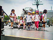 08 JUNE 2018 - SEOUL, SOUTH KOREA: Children in a school group at the War Memorial of Korea in Seoul, South Korea, play on a replica of the PKM-357 patrol boat sunk by the North Korean navy in 2002. With the near constant threat of invasion from North Korea, many South Koreans take great pride in the ability of their armed forces. Some observers believe there is a possibility that a peace agreement between South and North Korea could be signed following the Trump/Kim summit in Singapore. The War Memorial and museum opened in 1994 on the former site of the army headquarters to exhibit and memorialize the military history of Korea. When it opened in 1994 it was the largest building of its kind in the world. The museum features displays about the Korean War and many static displays of military equipment.    PHOTO BY JACK KURTZ