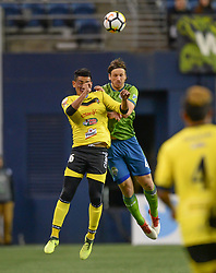 March 1, 2018 - Seattle, Washington, U.S - Soccer 2018: GUSTAV SVENSSON (4) and MARION CORNEJO (16) battle for possession as Santa Tecla FC visits the Seattle Sounders for a CONCACAF match at Century Link Field in Seattle, WA. (Credit Image: © Jeff Halstead via ZUMA Wire)