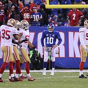 New York Giants quarterback Eli Manning at the end of the game during the New York Giants V San Francisco 49ers, NFL American Football match at MetLife Stadium, East Rutherford, NJ, USA. 16th November 2014. Photo Tim Clayton