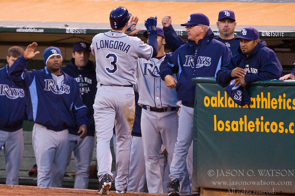 May 7, 2010; Oakland, CA, USA;  Tampa Bay Rays third baseman Evan Longoria (3) is congratulated by his team after scoring a run against the Oakland Athletics during the fourth inning at Oakland-Alameda County Coliseum. Tampa Bay defeated Oakland 4-1.