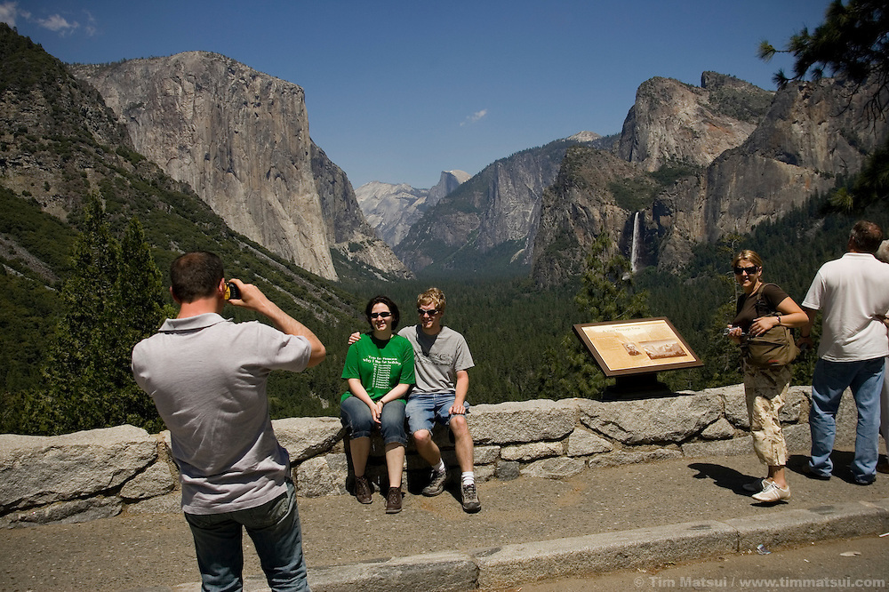 Tourists pose for a photo in Yosemite National Park.