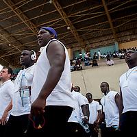 11/06/2013. Dakar, Senegal. Les joueurs de l'équipe de rugby du Senegal regardent le match du Botswana contre la Tunisie avant de disputer leur premier match de la demi-finale de la Coupe d'Afrique des Nations B contre la Namibie. ©Sylvain Cherkaoui