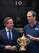 UNITED KINGDOM, London: 17 September 2015 On the eve of the Rugby World Cup the Webb Ellis trophy is brought to Downing Street to be treated by British Prime Minister David Cameron and held by ex English rugby player Martin Johnson in London, England. Pic by Andrew Cowie / Story Picture Agency