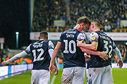 Millwall forward Matt Smith (10) celebrates with teammate,  Millwall defender Murray Wallace (3) after scoring a goal (2-1) during the EFL Sky Bet Championship match between Millwall and Charlton Athletic at The Den, London, England on 9 November 2019.
