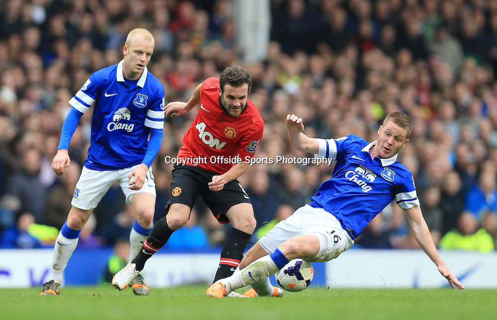 20th April 2014 - Barclays Premier League - Everton v Manchester United - James McCarthy of Everton tackles Juan Mata of Man Utd - Photo: Simon Stacpoole / Offside.