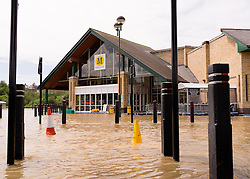© Licensed to London News Pictures. 09/06/2012. London, UK. The floodwater has surrounded a Morrisons Supermarket trapping staff inside. The River Rheidol, swollen after two days heavy rain, and with a high tide forcing the waters back, bursts its banks and floods low-lying areas of shops and houses on the outskirts of Aberystwyth Wales UK. Photo credit : Keith Morris/LNP
