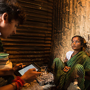 CAPTION: 32-year-old Sharada shares information about her illness with a TARU surveyor. LOCATION: Chikitsak Nagar, Indore, Madhya Pradesh, India. INDIVIDUAL(S) PHOTOGRAPHED: Sharada.