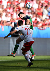 Paddy McNair of Northern Ireland battles for the high ball with Bartosz Kapustka of Poland  - Mandatory by-line: Joe Meredith/JMP - 12/06/2016 - FOOTBALL - Stade de Nice - Nice, France - Poland v Northern Ireland - UEFA European Championship Group C