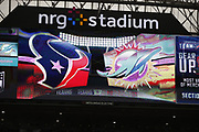 The Houston Texans and Miami Dolphins logos appear on the scoreboard during the NFL week 8 regular season football game against the Miami Dolphins on Thursday, Oct. 25, 2018 in Houston. The Texans won the game 42-23. (©Paul Anthony Spinelli)