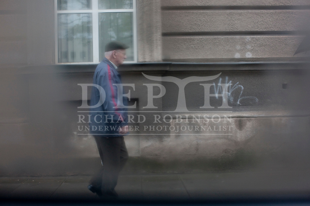 Old man walking on a rainy day in Krakow, Poland..Wednesday 05 May 2010.Photograph Richard Robinson © 2010.