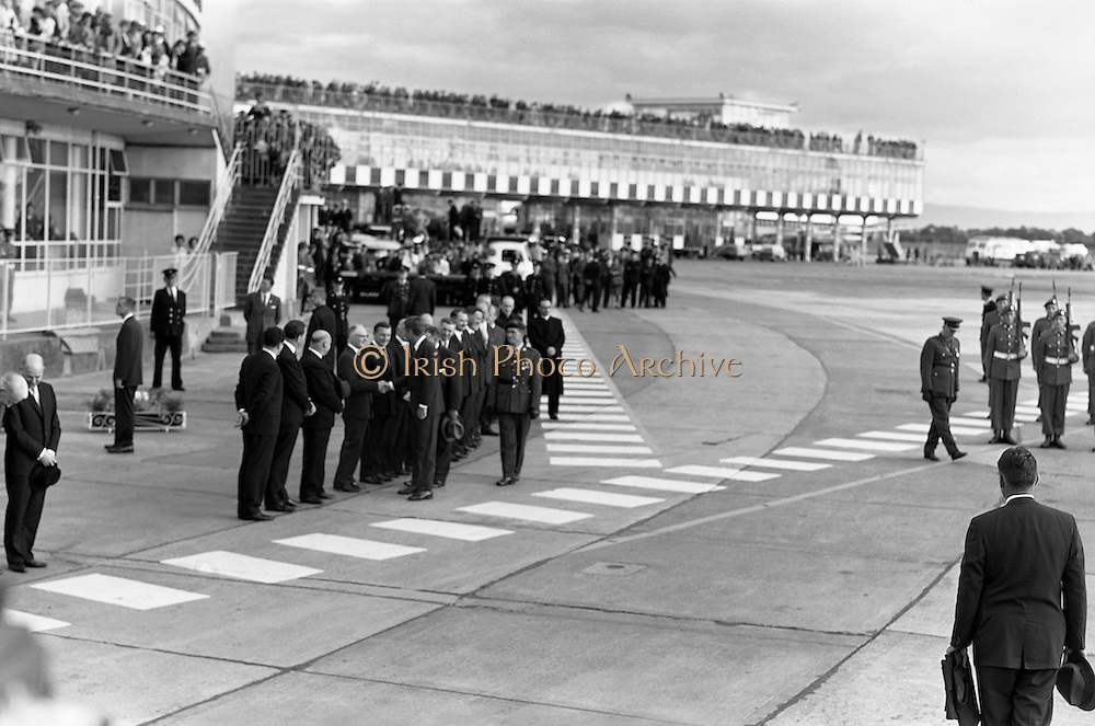 President John F. Kennedy arrives at Dublin Airport.  Kennedy replies to President de Valera's speech of welcome.  Onlookers include President Kennedy's sisters, Mrs. Eunice Shriver and Mrs. Jean Smith; An Taoiseach Seán Lemass; An Tanaiste Mr. Sean McAntee; Dr. James Ryan, Minister for Finance, and Mr. Frank Aiken, Minister for External Affairs.<br /> 26.06.1963